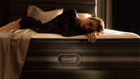woman laying on Beautyrest Black mattress